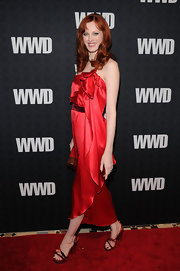 Karen Elson isn't afraid to wear bright colors.  This gorgeous silk gown is as luminous as her signature red hair as she struts down the red carpet at WWD's 100 Anniversary Gala.