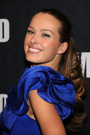 Petra let her ruffled dress do most of the talking on the red carpet, by pulling her hair back in a sleek pony.