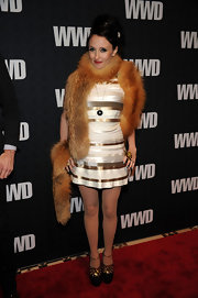 Alice & Olivia designer Stacey Bendet donned platform pumps with gold ankle straps and a gilded cut-out design.