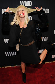 Betsey is in her usual cheerful spirit as she jumps around in her black ensemble and glitzy sequined jacket.