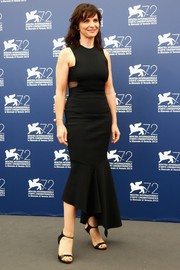 Black ankle-strap sandals with dangerous-looking stiletto heels completed Juliette Binoche's look.
