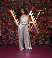 Gabrielle Union looked totally ready for the holidays in this silver jumpsuit from her collection with New York & Company during the Live Unforgettable Dinner Series.