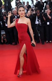 Salma was a vision in red, wearing a high-slit crimson gown that showed off a pair of satin, peep-toed pumps.