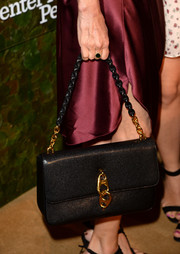 Courteney Cox complemented her burgundy dress with an elegant black shoulder bag when she attended the Wallis Annenberg Center Inaugural Gala.
