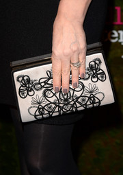 An embroidered box clutch added some brightness to Geena Davis' black outfit when she attended the Wallis Annenberg Center Inaugural Gala.