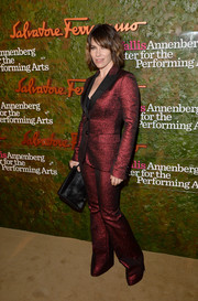 Evangeline Lilly was '70s-glam in an iridescent red Moschino pantsuit at the Wallis Annenberg Center Inaugural Gala.