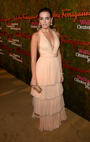 Camilla Belle showed plenty of skin at the Wallis Annenberg Center Inaugural Gala in a sophisticated pink Ferragamo halter gown with a deep-V neckline and a tiered skirt.