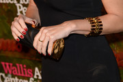 Paz Vega accessorized with a super-elegant textured black and gold tube clutch at the Wallis Annenberg Center Inaugural Gala.