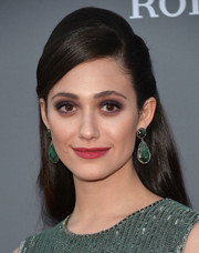 Emmy Rossum complemented her lovely 'do with a glamorous pair of dangling gemstone earrings.