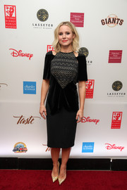 Kristen Bell sealed off her look with gold Christian Louboutin pumps.