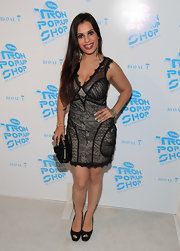 Vivica wears a sultry lace cocktail dress with a nude underlay to the 'Tron' Pop-up Shop.