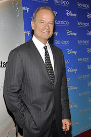 Kelsey Grammer complemented his striped suit with a paisley tie at the D23 Expo.