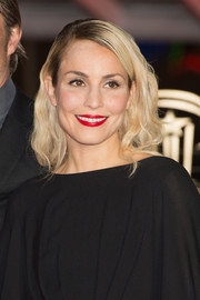 Noomi Rapace wore a vintage-glam wavy 'do when she attended the 'Waltz with Monica' photocall.