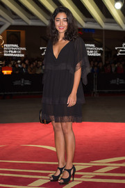 Golshifteh Farahani attended the 'Waltz with Monica' photocall wearing a lingerie-inspired little black dress.