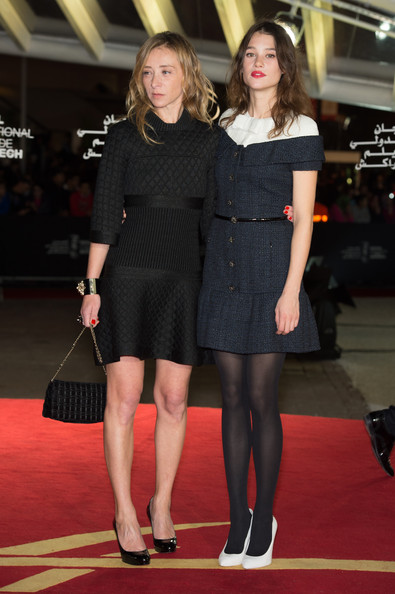 Astrid Berges Frisbey's white pumps looked jarring against her black pantyhose.