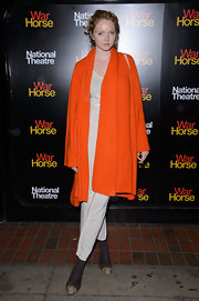 Lily Cole brought a bright pop of color to the 'War Horse' 5th anniversary performance with this oversized orange shawl-collar cardigan.