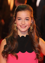 Celine Buckens attended the UK premiere of 'War Horse' wearing her hair half up and with long loose curls.