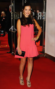 Celine Buckens looked sweet '60s in a hot pink frock with a scalloped neck.
