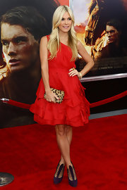 Tinsley Mortimer gave her red one-shoulder dress an exotic twist with a petite leopard print clutch at the premiere of 'War Horse.'
