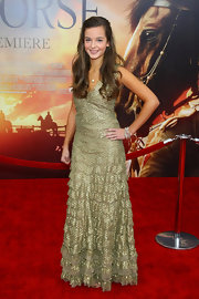 Celine Buckens shone on the 'War Horse' red carpet in a tiered gold evening dress.