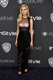 Nicola Peltz looked tough-glam at the Warner Bros. and InStyle Golden Globes post-party in a sheer-panel black Alexander Wang gown with leather and stud detailing.