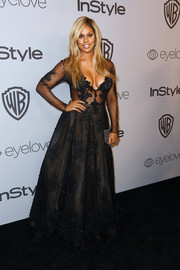 Laverne Cox made eyes pop with this plunging, sheer-bodice beaded gown by Stella Nolasco at the Warner Bros. and InStyle Golden Globes after-party.