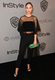 Cara Santana teamed her top with black cigarette pants, also by Monique Lhuillier.
