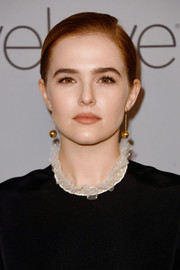 Zoey Deutch accessorized with a pair of dangling spheres at the Warner Bros. and InStyle Golden Globes after-party.