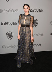 Crystal Reed opted for a Valentino print dress with a keyhole cutout when she attended the Warner Bros. and InStyle Golden Globes after-party.