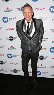 Sting's outfit popped with a black and white patterned scarf at the Warner Music Group's Grammy celebration.