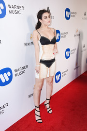 Charli XCX went playful with this lingerie-print slip dress by Moschino at the Warner Music Group Grammy party.