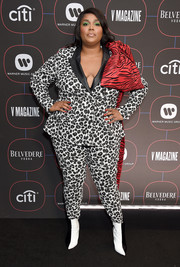 Lizzo sealed off her look with a pair of two-tone ankle boots.