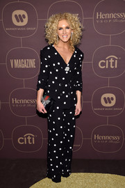 Kimberly Schlapman went for a playfully chic polka-dot suit by Monse when she attended the Warner Music Group pre-Grammy celebration.