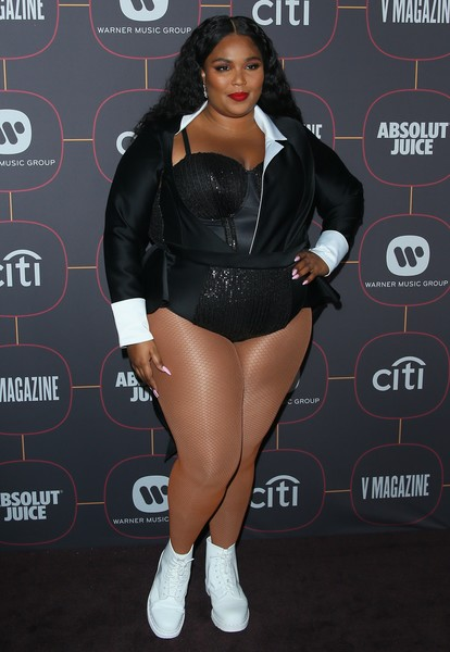 Lizzo hit the Warner Music Group pre-Grammy party wearing a black tuxedo bodysuit by Howie B.