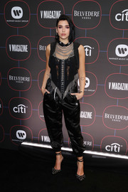 Dua Lipa teamed her top with black satin harem pants, also by Alexander Wang.