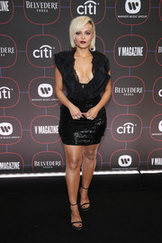 Bebe Rexha cut a flirty figure in a sequined LBD with a plunging ruffled neckline at the Warner Music pre-Grammy party.