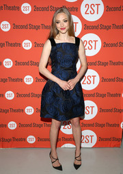 Amanda Seyfried paired her lovely dress with black crisscross-strap pumps by Christian Louboutin.
