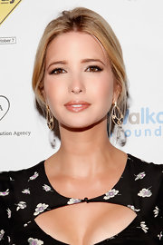 Ivanka Trump looked stunning at 'The Way' premiere. To get her sultry eye makeup look, begin by lining the upper and lower lash lines and the inner rims of eyes with a black or dark brown eye pencil. Next, sweep a rich, coppery shade of shadow on the outer edges of the eyelids and blend into creases. To finish the look, add false lashes and several coats of a volumizing mascara.