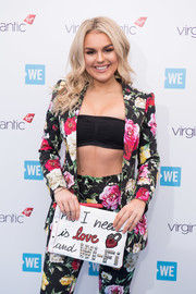 Tallia Storm teamed a black bandeau bra with a floral suit for WE Day UK.