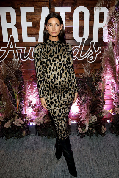 Lily Aldridge teamed her dress with a pair of black knee-high boots by Jimmy Choo.