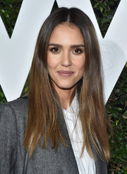 Jessica Alba wore her hair straight with a center part at the Who What Wear 10th anniversary event.