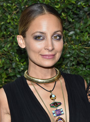 Nicole Richie accentuated her eyes with a heavy application of metallic shadow.