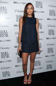 Ashley Madekwe was casual yet cool in a sleeveless navy Theory blouse and a matching mini at the Who What Wear event.
