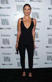 Cara Santana flaunted her killer curves in a low-cut black jumpsuit during the Who What Wear event.