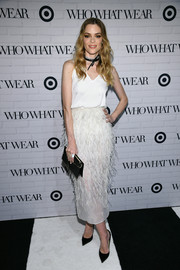 Jaime King wore a white Steven Kahlil feather skirt with her top for a chicer finish.