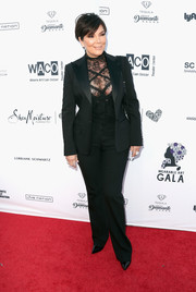 Kris Jenner went androgynous in a black suit teamed with a lace top at the Wearable Art Gala.