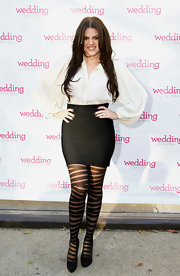 Black platform pumps were the most subdued part of Khloe Kardashian's ensemble, which consisted of bold striped tights and a pirate style blouse.