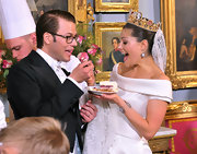 Princess Victoria wore an elaborate gold crown with a lace veil at her wedding banquet.