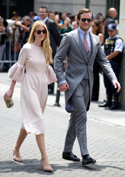 Beatrice Borromeo attended the wedding of Prince Christian of Hanover and Alessandra de Osma wearing a pale pink cocktail dress with bell sleeves.