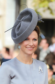Princess Madeleine's main accessory for the wedding was a stunning oversized gray fascinator that perfectly matched her dress.